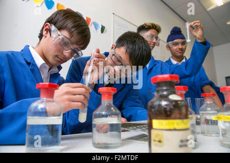 Boys (aged 14) during a Chemistry lesson at King Edward's School, Birmingham UK - Stock Photo