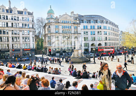 People relaxing on the steps outside St Paul's Cathedral, St Paul's Churchyard, London, England, UK - Stock Photo