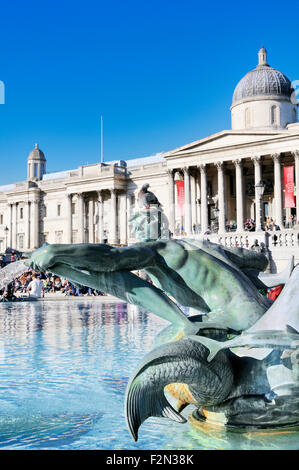 Pigeon sitting on the head of a statue in Trafalgar Square, London, England, UK - Stock Photo