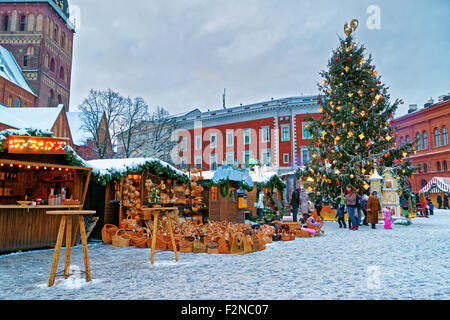 RIGA, LATVIA - DECEMBER 28, 2014: European Christmas fair stalls at Dome square in Old Riga (Litvia) with traditional - Stock Photo