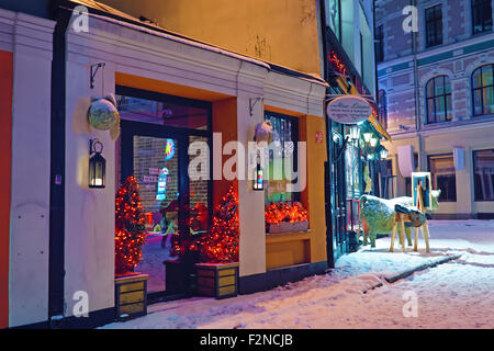 RIGA, LATVIA - DECEMBER 28, 2014: Architecture of the Old Town of Riga with Christmas decoration - Stock Photo