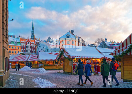 RIGA, LATVIA - DECEMBER 28, 2014: People stroll down an aisle at the Christmas Market held at Riga's Old Town (Dome - Stock Photo