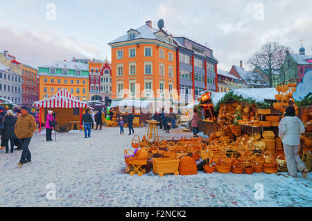 RIGA, LATVIA - DECEMBER 28, 2014: Handmade straw baskets, children buggies and other straw souvenirs for sale at - Stock Photo