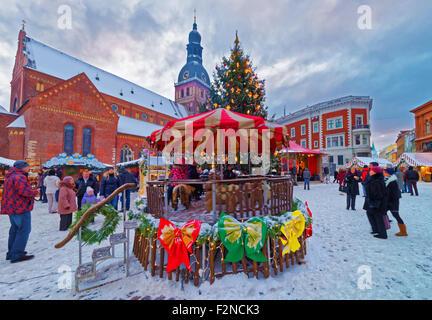 RIGA, LATVIA - DECEMBER 28, 2014: Traditional European Christmas market on the main square of Old Riga (Dome Square) - Stock Photo
