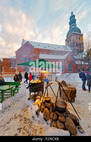 RIGA, LATVIA - DECEMBER 28, 2014:  Tourists enjoy the Christmas market in the city center on December 28, 2014 in - Stock Photo
