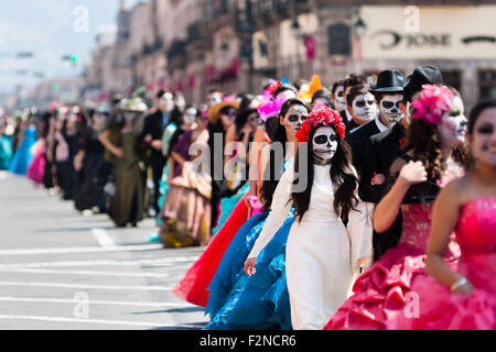 Young couples, costumed as 'La Catrina', walk through the town during the Day of the Dead festivities in Morelia, - Stock Photo