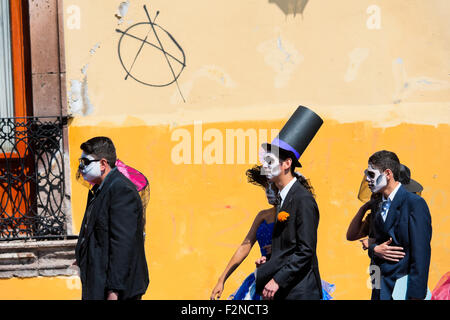 Young couples, costumed as 'La Catrina', walk through the town during the Day of the Dead celebration in Morelia, - Stock Photo