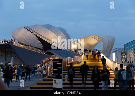 Milan, Italy, 13 September 2015: Night view of modern architecture of German exhibition hall at Milan Expo 2015 - Stock Photo