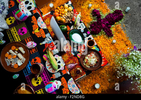Food offerings are placed at the altar of the dead during the Day of the Dead celebration in Morelia, Mexico. - Stock Photo