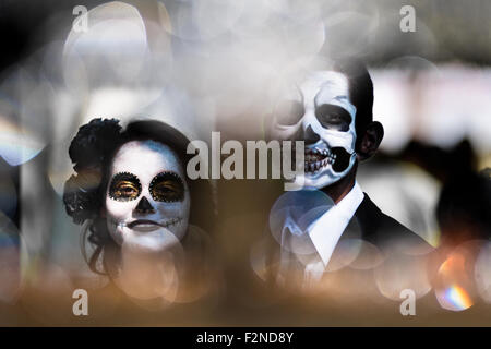 A young couple, costumed as 'La Catrina', walks through the town during the Day of the Dead celebration in Morelia, - Stock Photo