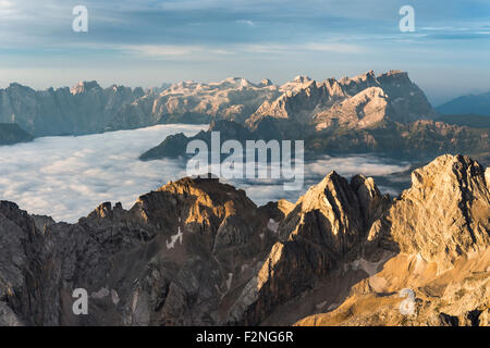 Dolomites at sunrise, view from the summit Punta Penia towards the south, highest peaks of the Dolomites, Marmolada - Stock Photo