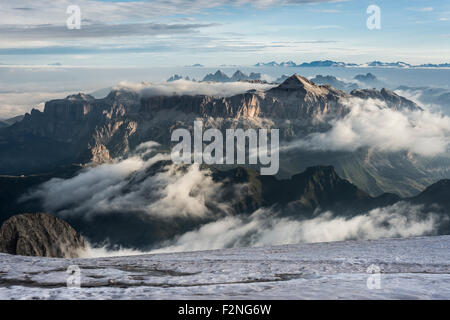 Sella group with Piz Boè, 3152 m, view from the peak Punta Penia, clouds, Marmolada, Dolomites, Alps, South Tyrol - Stock Photo
