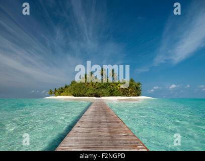 Wooden dock walkway to tropical island - Stock Photo