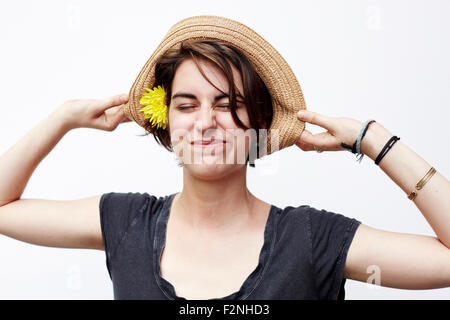 Close up of woman wearing straw hat - Stock Photo