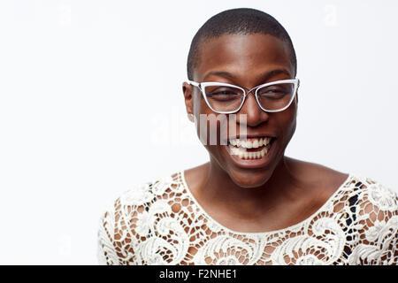 Smiling stylish woman wearing eyeglasses - Stock Photo
