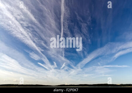cirrus clouds and blue sky with contrails - Stock Photo