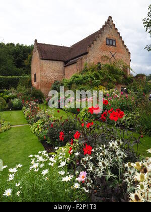 Portrait view of Chenies Manor Sunken garden with the Pavilion.Beautiful summer border plants;dahlias, daisies and - Stock Photo