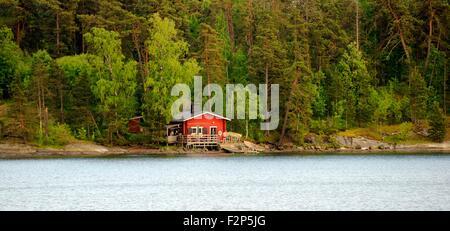Helsinki, Finland. Summer house sauna with boat landing on coast on east side of Helsinki - Stock Photo