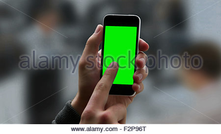 Chroma key screen smart phone touch screen. Male hand holding phone and touching the screen, copy space for your - Stock Photo