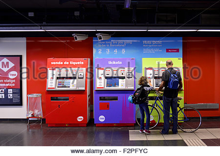Buying metro tickets from the automated vending machine in Barcelona Spain Europe Stock Photo