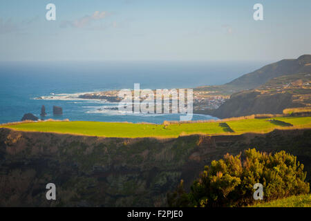 Coastal landscape from Sao Miguel island, Azores islands, Portugal, with the parish of Mosteiros on the background. - Stock Photo