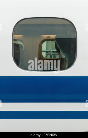 Looking in through a window on a bullet train - Stock Photo