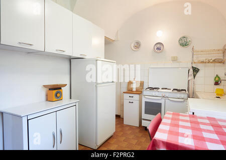 Old kitchen in normal house in Italy - Stock Photo