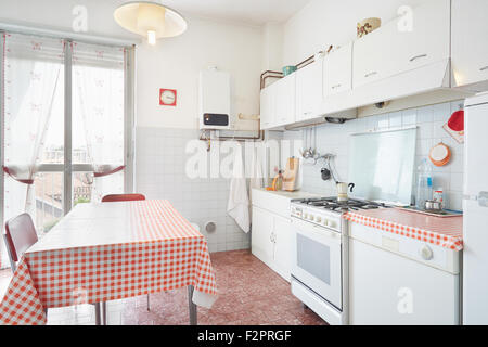 Old kitchen in normal house interior - Stock Photo