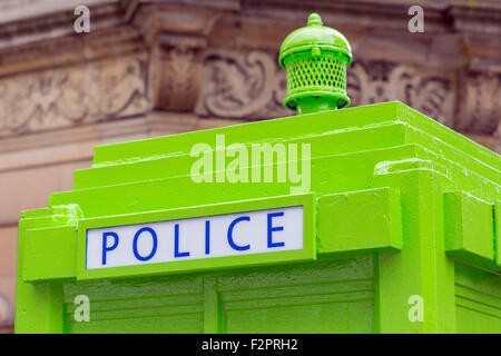 An old style Police Phone Box painted lime green in Glasgow, Scotland, UK - Stock Photo