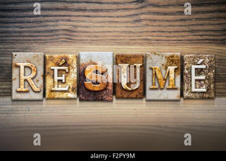 the word resume written in rusty metal letterpress type isolated