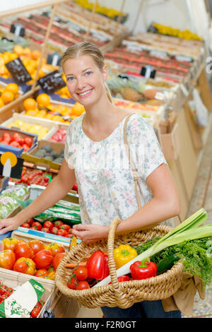 Lady buying vegetables - Stock Photo