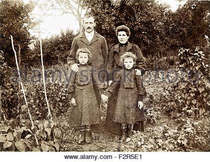 vintage family portrait in garden France - Stock Photo