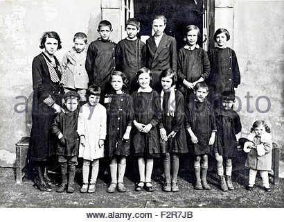 various aged school children and teacher rural France c 1930s - Stock Photo