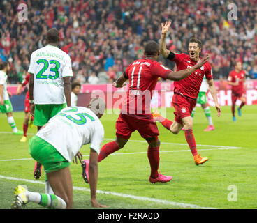 Robert LEWANDOWSKI (FC Bayern), Douglas COSTA (FC Bayern), Joshua GUILAVOGUI (VfL Wolfsburg) and NALDO (VfL Wolfsburg) - Stock Photo