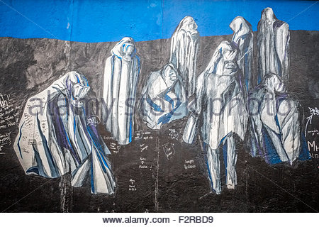 Berlin Wall Art political art spray painted on to the berlin wall. seen at the