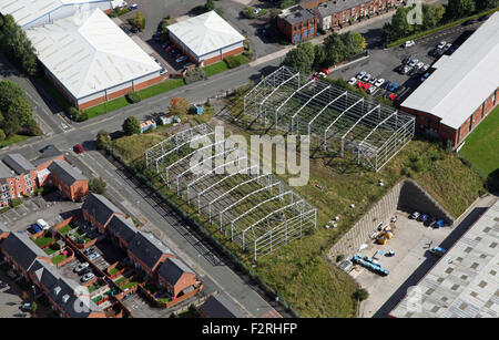 aerial view of two industrial units under construction in Manchester, UK - Stock Photo