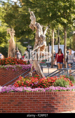 Reminiscence by sculpture Tuan along Main Street in downtown Greenville, South Carolina. - Stock Photo