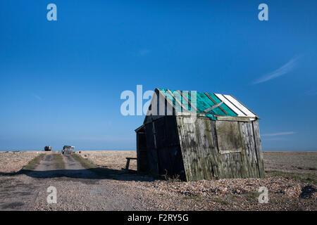 Abandoned old fishing hut and path on the shingle beach, Dungeness, Kent, England, UK - Stock Photo