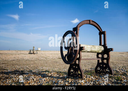 Abandoned old winch machinery on the shingle beach of Dungeness, Kent, England, UK - Stock Photo
