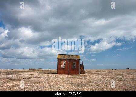 Abandoned old fishing hut on the shingle beach, Dungeness, Kent, England, UK - Stock Photo