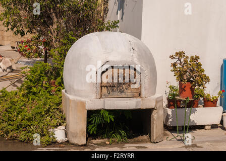 Traditional Greek and Cypriot wood fired brick clay oven in tavern outdoor. Mediterranean cuisine. Zygi. Cyprus. - Stock Photo