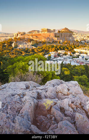 Evening view of Acropolis from Filopappou hill in central Athens. - Stock Photo