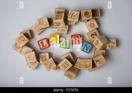 children's word blocks spelling out the word learn - Stock Photo
