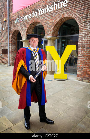 Sir Gary Verity with his Honorary Doctorate in Business Administration from Leeds Beckett University - Stock Photo