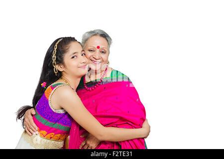 2 indian Grandmother and Granddaughter Hugging Diwali festival - Stock Photo