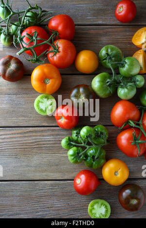 tomatoes on wooden boards, top view - Stock Photo