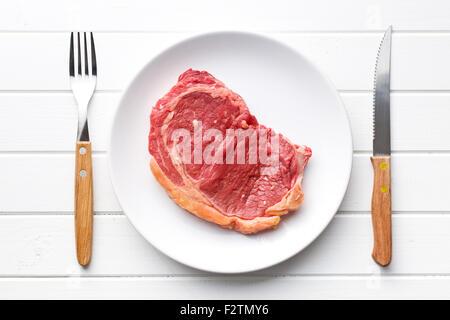 fresh raw beef on plate - Stock Photo