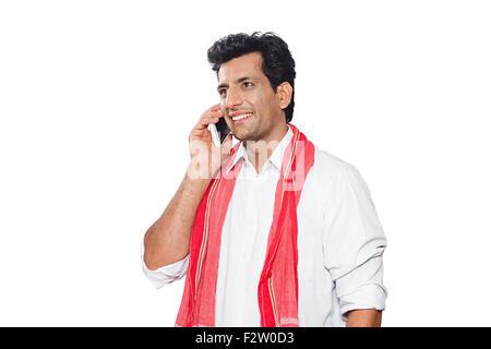 1 indian Adult man Rural Farmer Talking Mobile Phone - Stock Photo