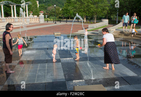 Asheville North Carolina Pack Square with children playing in fountains in park - Stock Photo