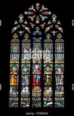 Beautiful stained glass window at the Church of Saint Catherine (14th century) in Mechelen, Belgium - Stock Photo